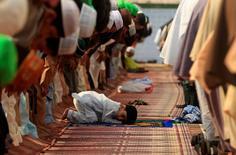A boy attends Eid al-Fitr prayers with others at Jamia Masjid in Rawalpindi, Pakistan. REUTERS/Faisal Mahmood