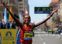Kenya's Rita Jeptoo reacts after winning the women's division at the 118th running of the Boston Marathon in Boston, Massachusetts April 21, 2014.  REUTERS/Brian Snyder
