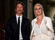 Italian designers Maria Grazia Chiuri and Pier Paolo Piccioli appear at the end of their Haute Couture Fall/Winter 2016/2017 collection for fashion house Valentino in Paris, France, July 6, 2016.  REUTERS/Gonzalo Fuentes