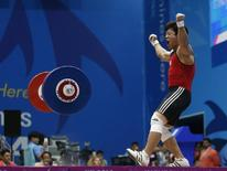 South Korea's Sa Jae-hyouk reacts to a successful lift of 171kg in the men's 85kg snatch weightlifting competition at the Moonlight Festival Garden during the 17th Asian Games in Incheon September 24, 2014.    REUTERS/Jason Reed