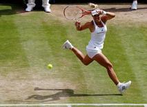 Britain Tennis - Wimbledon - All England Lawn Tennis & Croquet Club, Wimbledon, England - 7/7/16 Germany's Angelique Kerber in action against USA's Venus Williams REUTERS/Stefan Wermuth