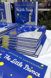 """Copies of """"The Little Prince"""" by French author Antoine de Saint-Exupery are seen at the unveiling of a statue of the book's main character in Northport, New York, September 16, 2006. REUTERS/Chip East"""