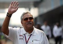 Force India team principal Vijay Mallya waves in the paddock during the third practice session of the Indian F1 Grand Prix at the Buddh International Circuit in Greater Noida, on the outskirts of New Delhi, October 27, 2012.  REUTERS/Ahmad Masood