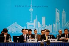 China's Commerce Minister Gao Hucheng (2nd L) attends the opening ceremony of the 2016 G20 Trade Ministers Meeting in Shanghai, China July 9, 2016. REUTERS/Aly Song