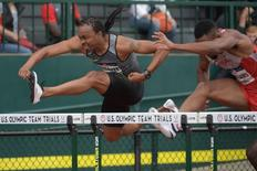 Jul 8, 2016; Eugene, OR, USA; Aries Merritt (left) and Issac Williams (right) compete during the men's 1100m hurdles first round heats in the 2016 U.S. Olympic track and field team trials at Hayward Field. Mandatory Credit: Kirby Lee-USA TODAY Sports