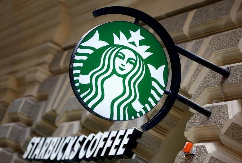 A Starbucks logo is seen at a Starbucks coffee shop in Vienna, Austria, June 21, 2016.    REUTERS/Leonhard Foeger