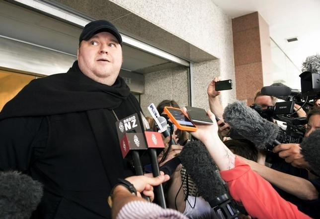 German tech entrepreneur Kim Dotcom speaks to the press after appearing in an Auckland courthouse, December 23, 2015. REUTERS/Chris Cameron