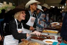 Alberta Premier Rachel Notley serves pancakes during the annual Premier's Calgary Stampede breakfast in Calgary, Alberta, Canada July 11, 2016. REUTERS/Todd Korol