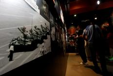 "A photo of ""Tank Man"" is displayed inside the June 4th Museum, which commemorates the 1989 crackdown on protesters in Beijing's Tiananmen Square, during its last day of opening in Hong Kong, China July 11, 2016.   REUTERS/Bobby Yip"
