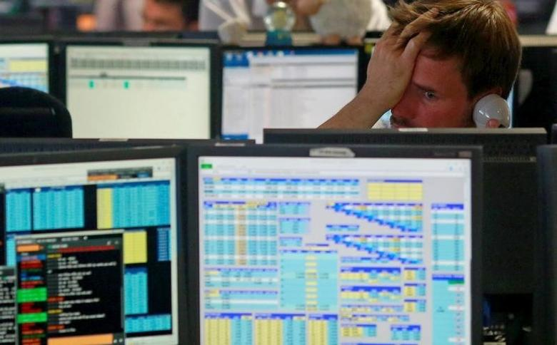 Traders from BGC, a global brokerage company in London's Canary Wharf financial centre react as European stock markets open early June 24, 2016 after Britain voted to leave the European Union in the EU BREXIT referendum.       REUTERS/Russell Boyce/File Photo
