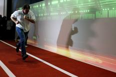 Rio's mayor Eduardo Paes runs after a news conference at the Olympic City museum in Rio de Janeiro, Brazil, July 5, 2016. REUTERS/Bruno Kelly