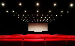 AMC Entertainment Holdings a annoncé mardi l'achat du britannique Odeon & UCI Cinemas Group, donnant naissance au premier réseau mondial de salles de cinéma. /Photo d'archives/REUTERS/Regis Duvignau