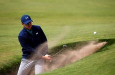 Golf - British Open - practice round - Royal Troon, Scotland, Britain - 12/07/2016. Jordan Spieth of the U.S. hits out of a bunker on the fourth hole. REUTERS/Paul Childs