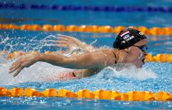 Inge Dekker of the Netherlands swims to win the women's 100m butterfly event of the FINA Swimming World Cup in Singapore November 1, 2014. REUTERS/Edgar Su