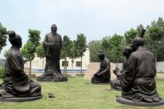 Sculptures of Confucius with his students are seen near the headquarters office building of Chambroad Holding in Boxing, Shandong Province, China, June 27, 2016. REUTERS/Aizhu Chen
