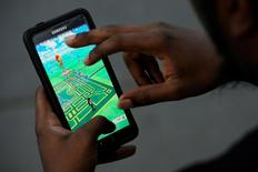 """A virtual map of Bryant Park is displayed on the screen as a man plays the augmented reality mobile game """"Pokemon Go"""" by Nintendo in New York City, U.S. July 11, 2016. REUTERS/Mark Kauzlarich"""