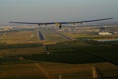 Solar Impulse 2, the solar powered airplane, piloted by Swiss pioneer Bertrand Piccard prepares to land in Seville, Spain, after finishing a 70 hours flight over the Atlantic ocean, June 23, 2016.  Jean Revillard/SI2/Handout via Reuters