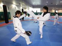 South Korean taekwondo athlete Cha Dong-min (front R) attends training at Taereung National Village in Seoul April 23, 2012. REUTERS/Kim Hong-Ji