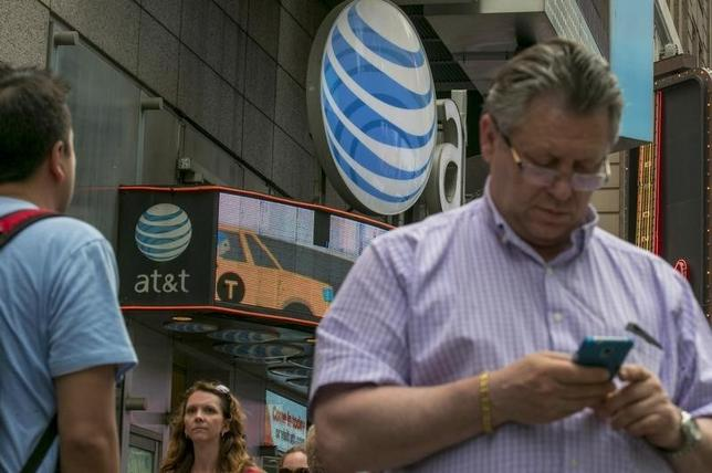 A man uses his phone outside the AT&T store in New York's Times Square, June 17, 2015.  REUTERS/Brendan McDermid