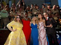 """Director Paul Feig poses with cast members (L-R) Melissa McCarthy, Leslie Jones, Kate McKinnon and Kristen Wiig pose at the premiere of the film """"Ghostbusters"""" in Hollywood, California U.S., July 9, 2016. REUTERS/Mario Anzuoni"""