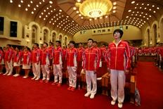 China's athletes for the 2016 Rio Olympics sing the Chinese national anthem during a gathering in Beijing, China, before going to Brazil,  July 18, 2016. Picture taken July 18, 2016. REUTERS/Stringer