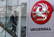 A man walks down a staircase next to a Vauxhall sign in London September 10, 2009.  REUTERS/Stefan Wermuth