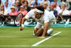 Britain Tennis - Wimbledon - All England Lawn Tennis & Croquet Club, Wimbledon, England - 8/7/16 Switzerland's Roger Federer falls during his match against Canada's Milos Raonic REUTERS/Clive Brunskill