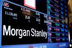 Информация об акциях Morgan Stanley на Нью-Йоркской фондовой бриже. Morgan Stanley сообщил о падении скорректированной прибыли во втором квартале, поскольку банку не удалось покрыть снижением издержек падение выручки от торговли и инвестиционной деятельности. REUTERS/Lucas Jackson