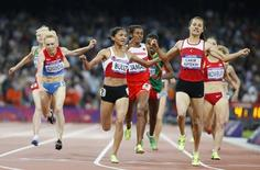 Turkey's Asli Cakir Alptekin (R) wins gold ahead of her compatriot second placed Gamze Bulut (3rd L) and third placed Bahrain's Maryam Yusuf Jamal (C) in the women's 1500m final during the London 2012 Olympic Games at the Olympic Stadium August 10, 2012. REUTERS/Lucy Nicholson