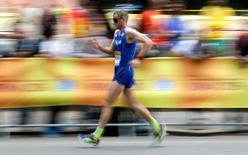 Alex Schwazer of Italy walks on his way to win the 50 kilometres race walk at the World Race Walking Team Championships in Rome, Italy, May 8, 2016.  REUTERS/Max Rossi