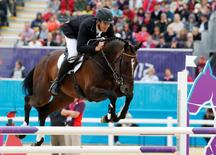 New Zealand's Jonathan Paget, riding Clifton Promise, clears a fence during the Eventing Jumping equestrian event at the London 2012 Olympic Games in Greenwich Park, July 31, 2012.  REUTERS/Mike Hutchings