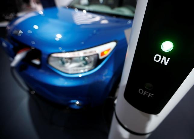 A Kia Soul EV is plugged into a charging station in Detroit, Michigan, in this file photo dated January 13, 2015. REUTERS/Mark Blinch