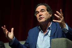 U.S. film director and screenwriter Oliver Stone speaks during a discussion with students at the University of Puerto Rico in San Juan in this file photo dated November 30, 2012. REUTERS/Ana Martinez