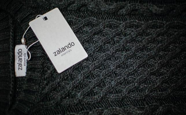 A Zalando label lies on an item of clothing in a showroom of the fashion retailer Zalando in Berlin October 14, 2014.  REUTERS/Hannibal Hanschke/File Photo