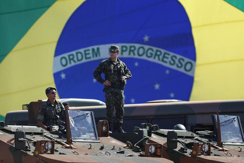 Brazilian police and military special forces are pictured outside the Mane Garrincha National Stadium, which will be one of the venues for the soccer competition of the 2016 Rio Olympic Games, during a presentation of the security scheme in Brasilia, Brazil July 22, 2016. REUTERS/Adriano Machado