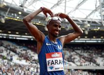 Jul 23, 2016; London, United Kingdom; Mo Farah (GBR) celebrates after winning the 5,000m in 12:59.29 in the London Anniversary Games during an IAAF Diamond League meet at Olympic Stadium. Mandatory Credit: Kirby Lee-USA TODAY Sports