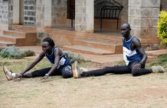 Rose Nathike Lokonyen and James Nyang Chiengjiek, refugees from South Sudan, part of the refugee athletes who qualified for the 2016 Rio Olympics, stretch during a training session at their camp in Ngong township near Kenya's capital Nairobi, June 9, 2016. REUTERS/Thomas Mukoya
