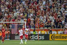 May 28, 2016; Harrison, NJ, USA;  New York Red Bulls forward Bradley Wright-Phillips (99) leaves the field while being congratulated by defender Connor Lade (5) during the 2nd half between the New York Red Bulls and Toronto FC at Red Bull Arena. New York won, 3-0.  Mandatory Credit: Vincent Carchietta-USA TODAY Sports