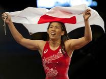 Sep 9, 2015; Las Vegas, NV, USA; Saori Yoshida of Japan displays her nation's colors while celebrating a victory in a medal round on the third night of the World Wrestling Championships at The Orleans Arena. Mandatory Credit: Stephen R. Sylvanie-USA TODAY Sports