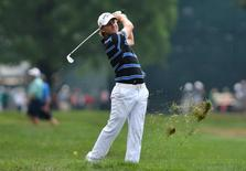 Jul 29, 2016; Springfield, NJ, USA; Emiliano Grillo hits his second shot on the 17th hole during the second round of the 2016 PGA Championship golf tournament at Baltusrol GC - Lower Course. Mandatory Credit: Eric Sucar-USA TODAY Sports