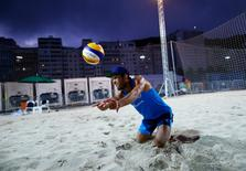 Beach volleyball player Paulo Nicolai of Italy trains July 30, 2016. REUTERS/Ivan Alvarado