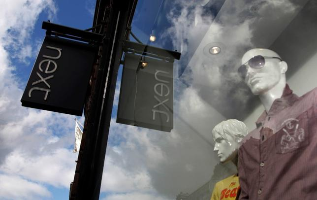 Mannequins are seen in the window of a Next clothing store in London March 26, 2009.  REUTERS/Luke MacGregor/File Photo