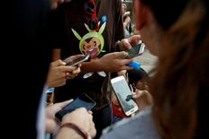 "Fãs jogando ""Pokémon Go"" na Puerta del Sol, centro de Madri 28/7/2016 REUTERS/Sergio Perez"