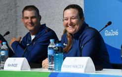 Aug 4, 2016; Rio de Janeiro, Brazil; Kim Rhode (right, USA) and Glenn Eller (left, USA) speak during a press conference at Main Press Center for the Rio 2016 Summer Olympic Games. Mandatory Credit: Shanna Lockwood-USA TODAY Sports