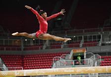 2016 Rio Olympics - Gymnastics training - Rio Olympic Arena - Rio de Janeiro, Brazil - 04/08/2016. Simone Biles (USA) of USA trains on the beam. REUTERS/Dylan Martinez