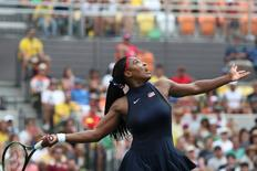 Aug 7, 2016; Rio de Janeiro, Brazil; Serena Williams (USA) hits a forehand to Daria Gavrilova (AUS, not pictured) during the women's singles in the Rio 2016 Summer Olympic Games at Olympic Tennis Centre. Mandatory Credit: Jeff Swinger-USA TODAY Sports