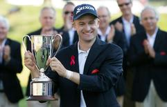 Aug 7, 2016; Cromwell, CT, USA;  Russell Knox holds the championship trophy after winning the 2016 Travelers Championship golf tournament at TPC River Highlands. Mandatory Credit: Bill Streicher-USA TODAY Sports