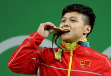 2016 Rio Olympics - Weightlifting - Final - Men's 56kg - Riocentro - Pavilion 2 - Rio de Janeiro, Brazil - 07/08/2016. Long Qingquan (CHN) of China (PRC) poses with his medal. REUTERS/Stoyan Nenov