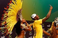 2016 Rio Olympics - Athletics - Rio de Janeiro, Brazil - 08/08/2016. Usain Bolt dances samba at a press conference. REUTERS/Nacho Doce