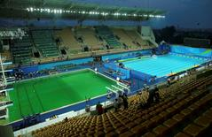 A general view of the Olympic diving pool and the pool for the waterpolo and synchronized swimming. The water in the Olympic diving pool appeared to turn a bright green hue on Tuesday, causing puzzlement among divers and audiences as the women's 10 meter platform final progressed, contrasting sharply against the still-blue color of another pool beside it. REUTERS/Antonio Bronic
